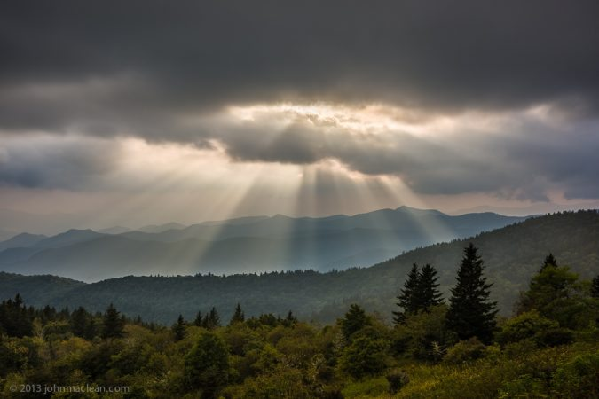 """Sunrays from Cowee Mountains Overlook, Milepost 430.7"" by John MacLean Photography"