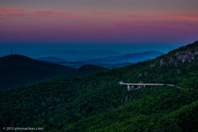 """Linn Cove Viaduct from Rough Ridge Overlook – Milepost 302.8"" by John MacLean Photography"